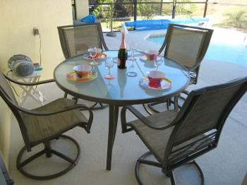 Outdoor dining - covered lanai with fan and dining table