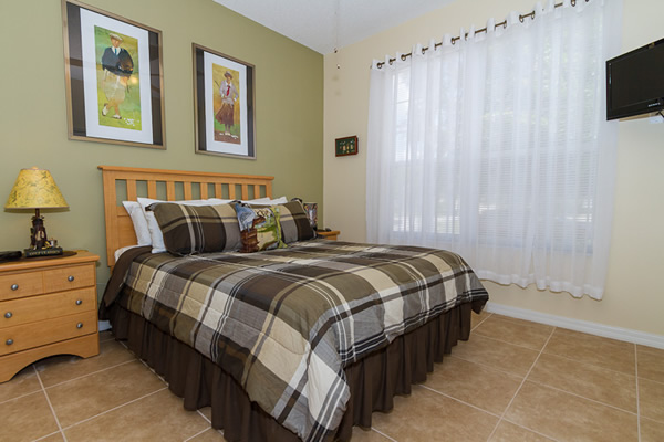 Queen Ensuite Master Bedroom with Golfing Theme Photo 1