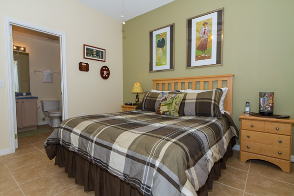 Queen Ensuite Master Bedroom with Golfing Theme Photo 2